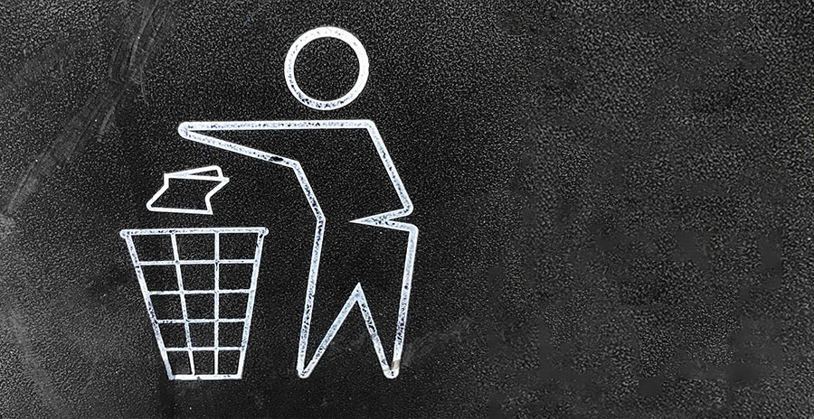 A white sketch on a black background of a person throwing a piece of trash into a waste basket